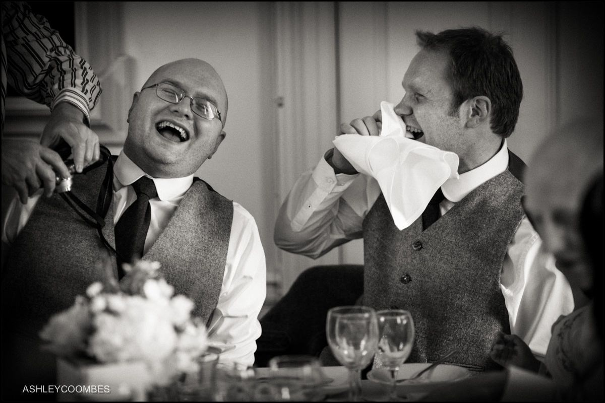 laughing at the groom's speech
