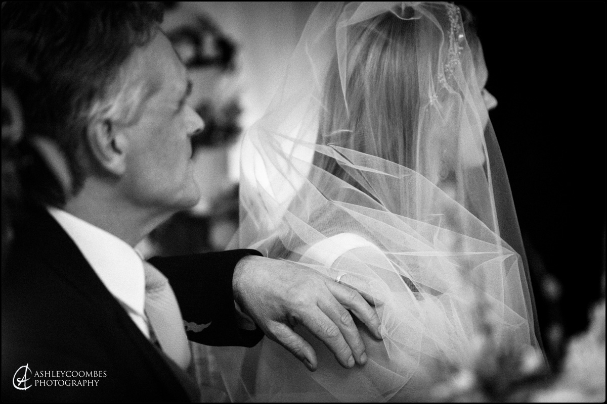 The comfort of dad's touch. Documentary wedding photography