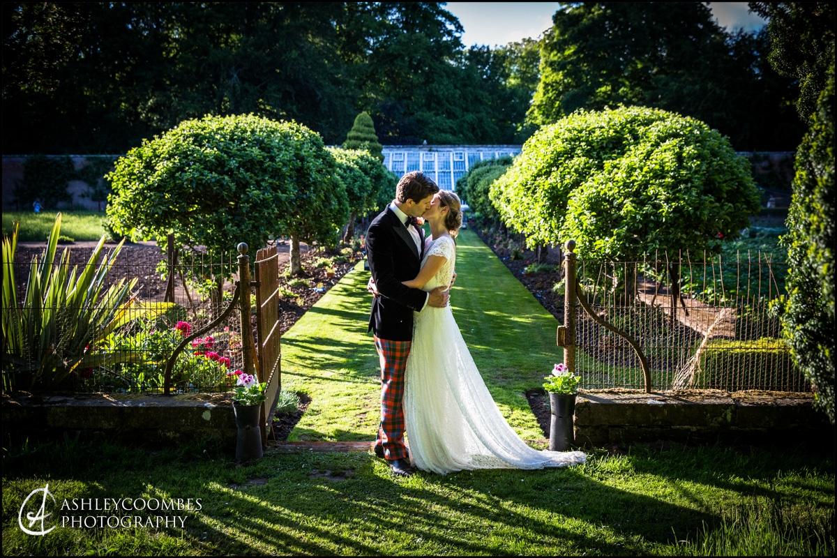 Bride and Groom wedding portrait in walled garden