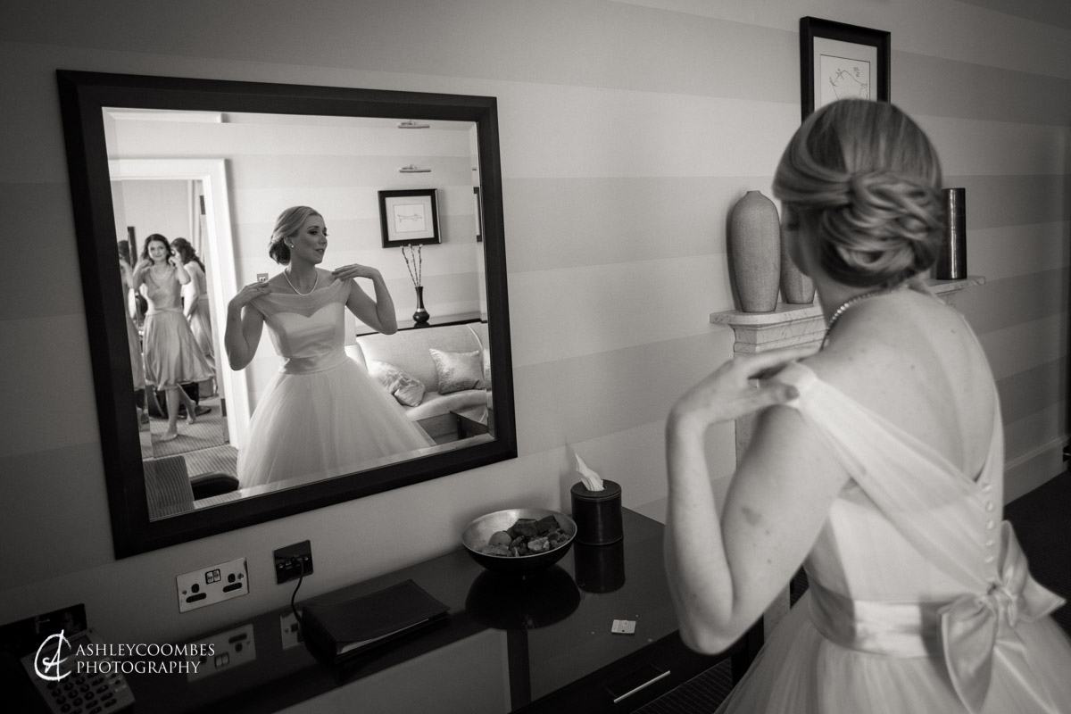 bride adjusts dress