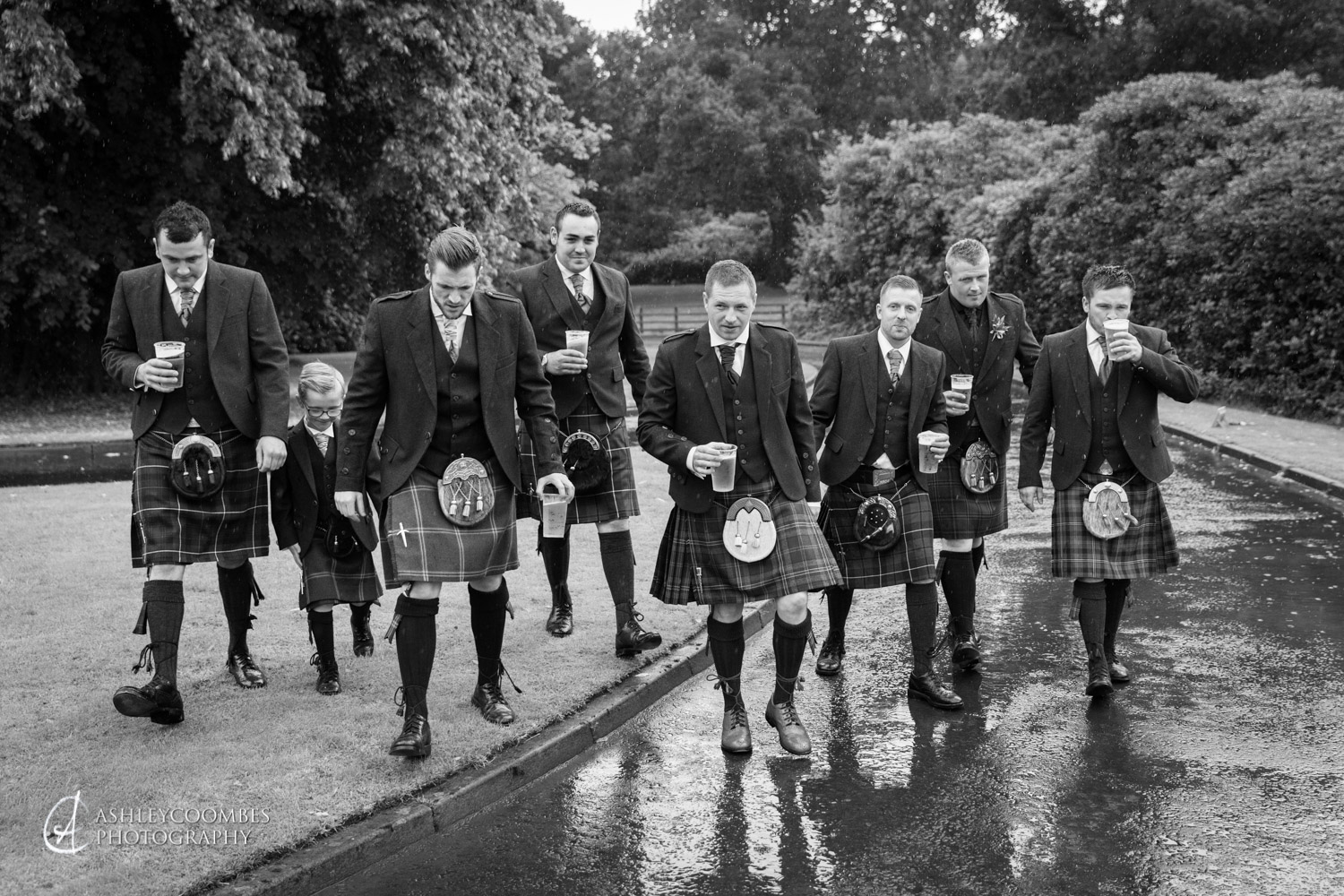 Chris with groomsmen in the rain