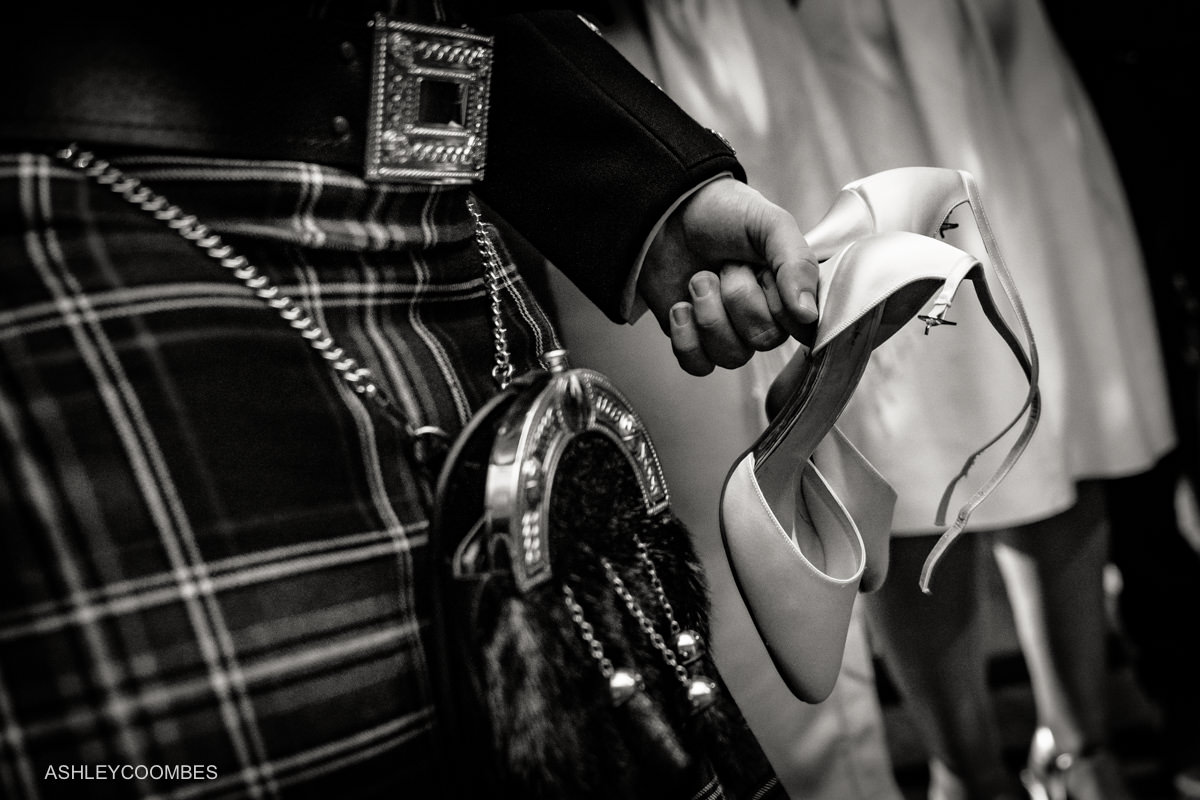 holding brides shoes