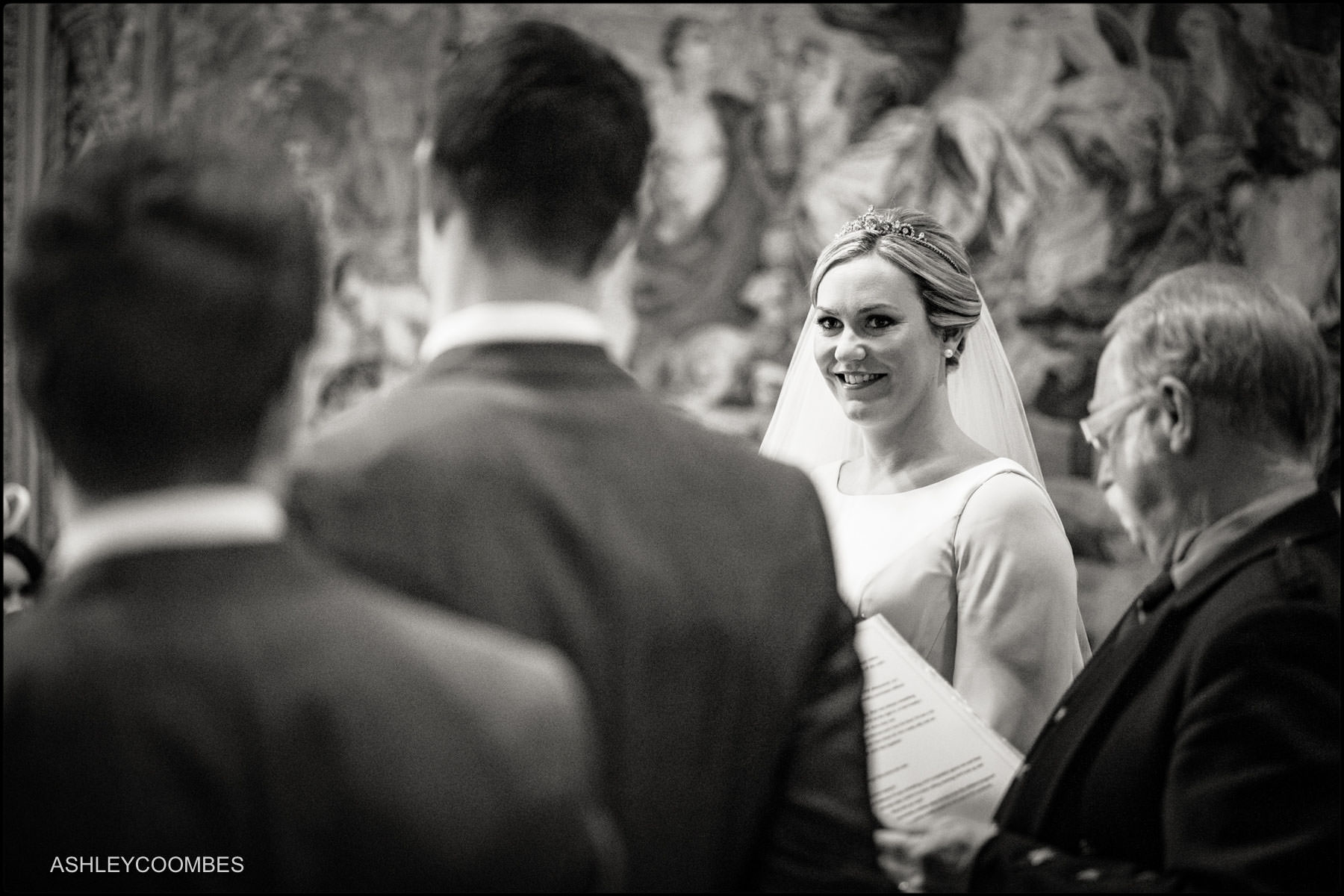bride looks at groom