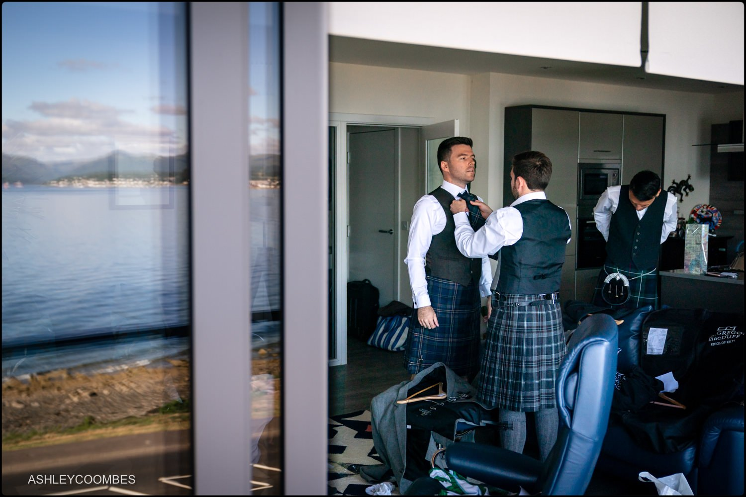 Groom with reflection of sea