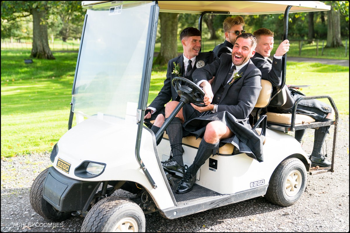Groomsmen arriving in golf buggy