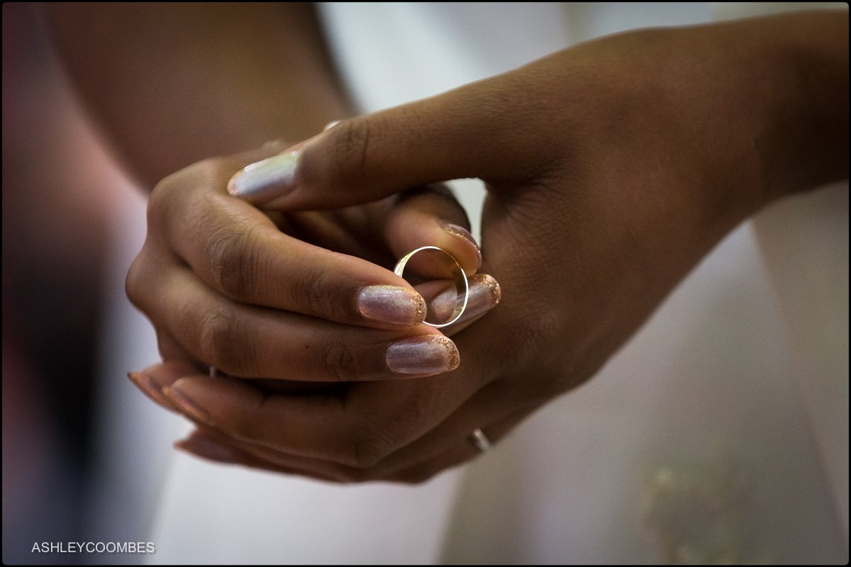 bride holding the ring