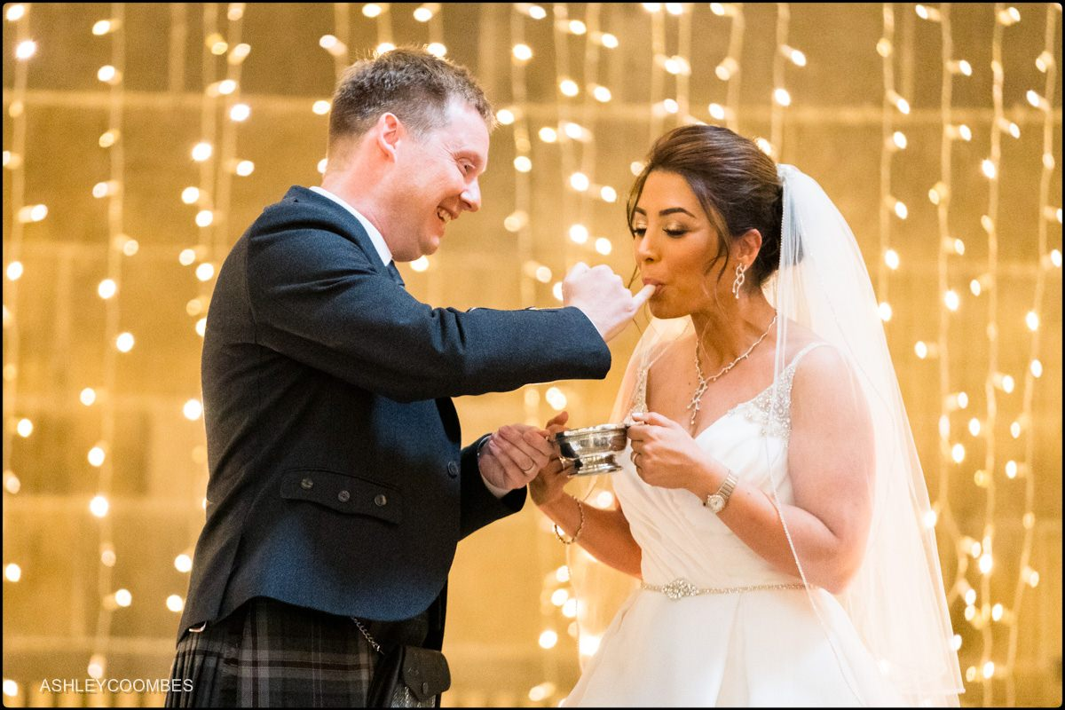 Honey in the quaich. documentary wedding photographer