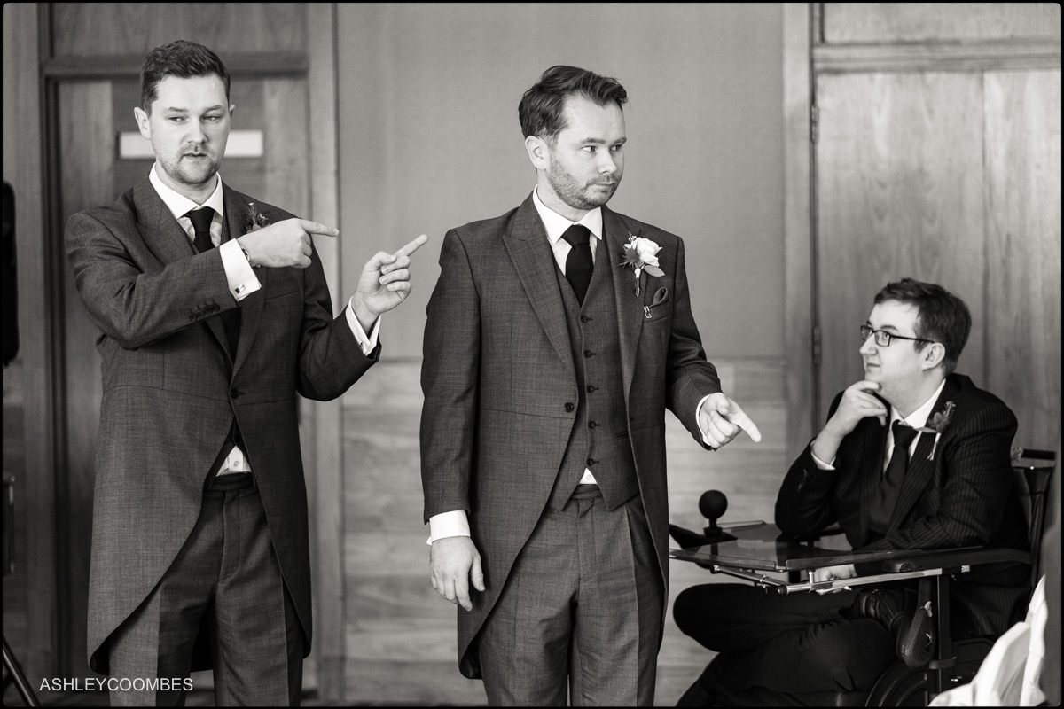 groomsmen deciding what goes where.