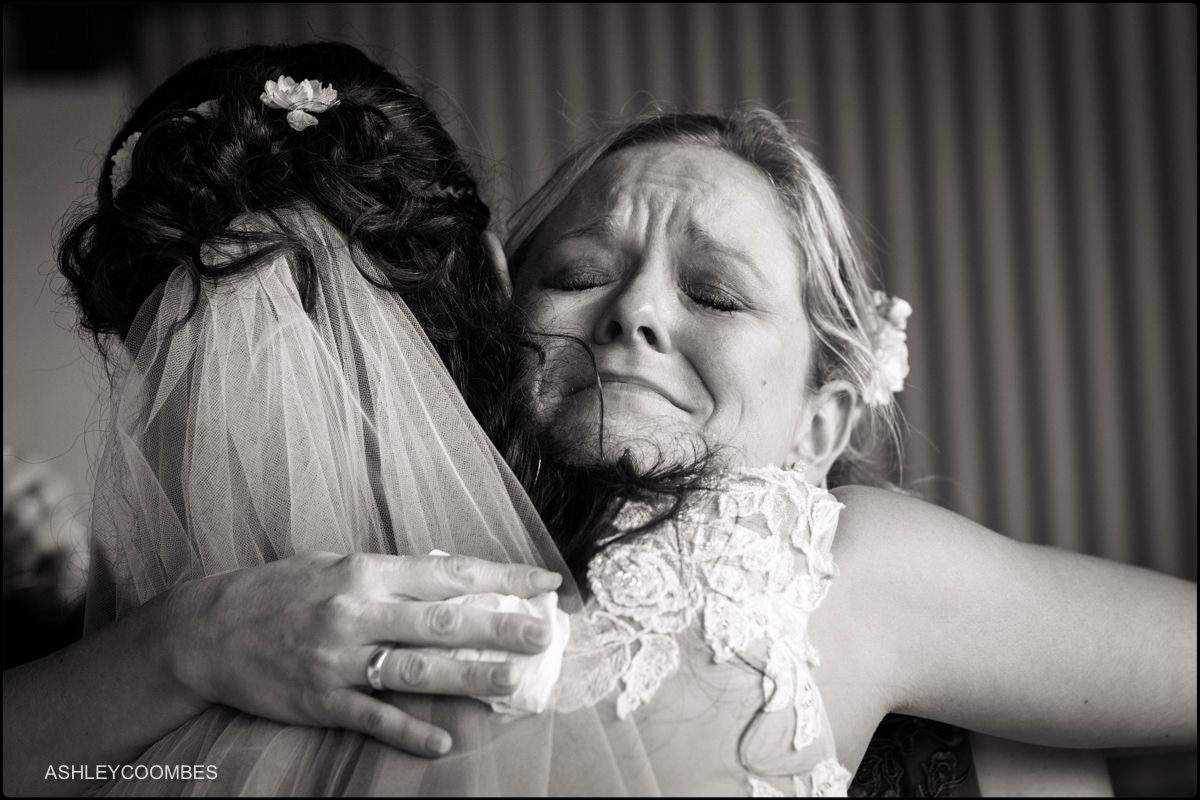 emotional hug for the bride